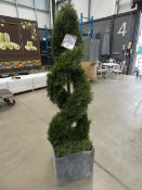 Artificial twisted conifer in pot