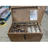 Wooden box containing large heavy duty spanners, hammers, screwdrivers, and various other tools