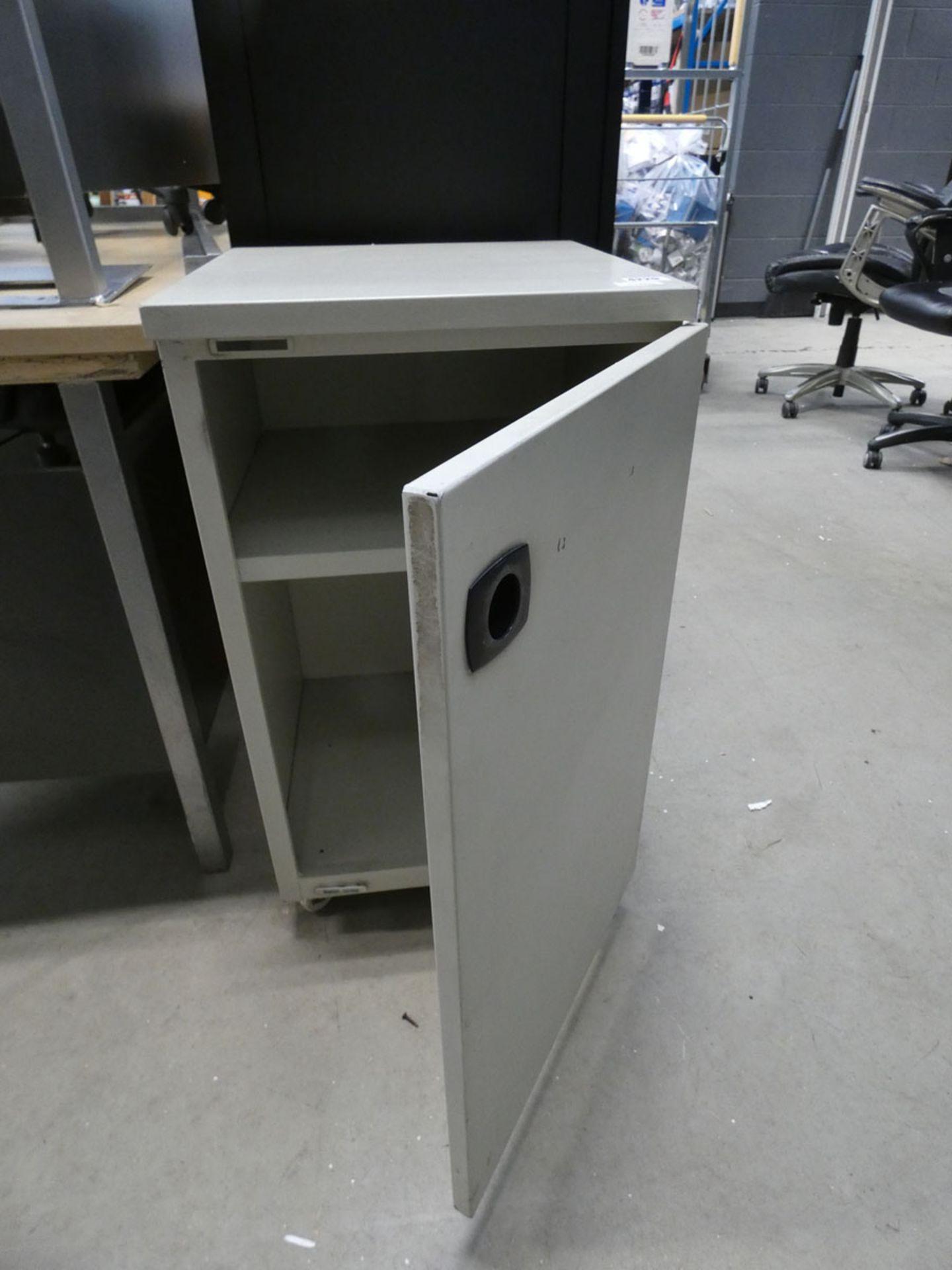 Cream metal cupboard with single door