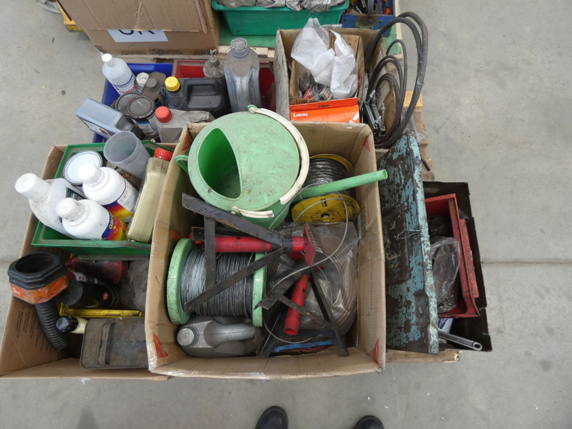Pallet containing wire cable, axle stands, watering can, chemicals, funnels, spanners, oil, clamps
