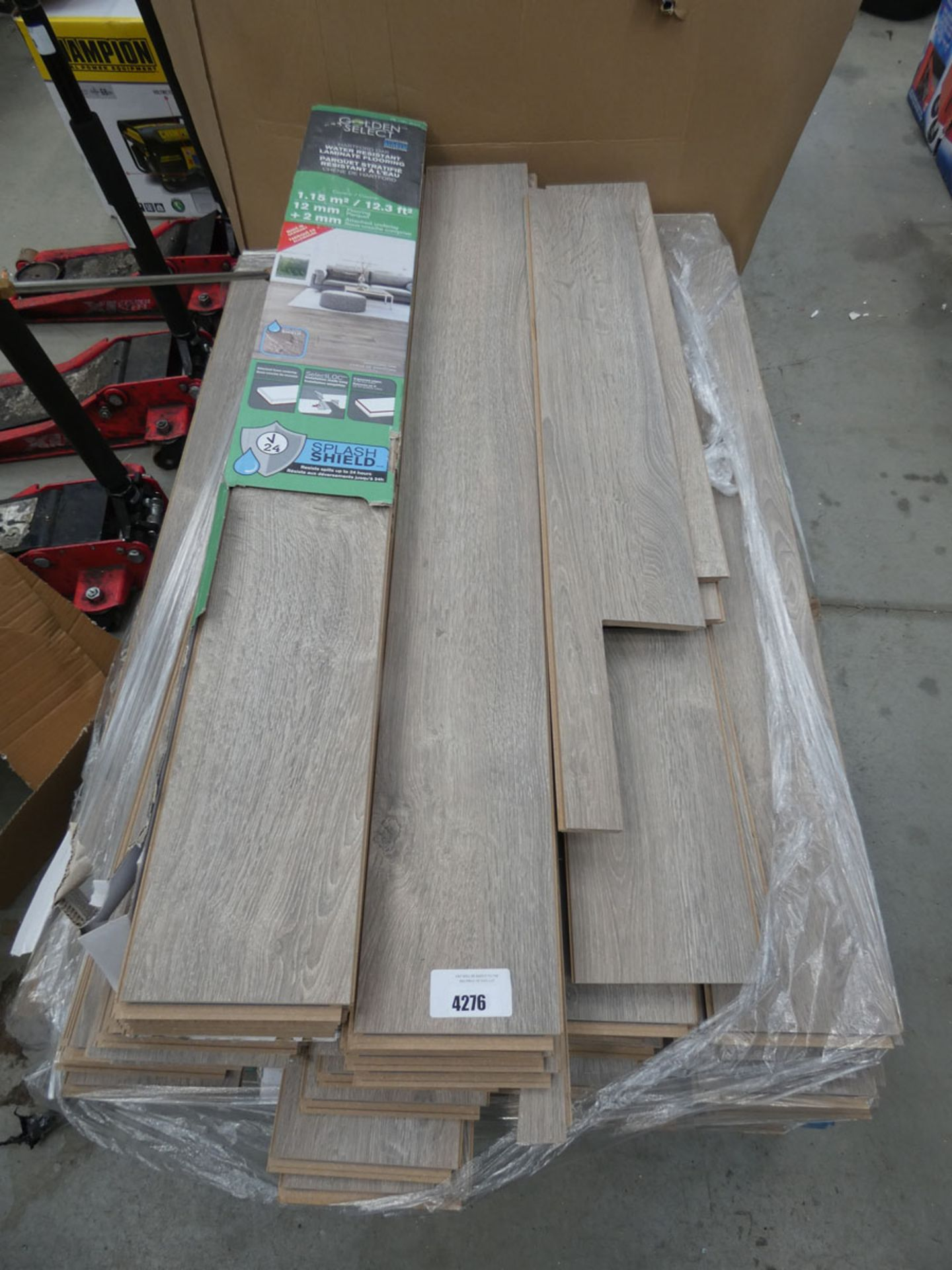 4438 Large pallet of Golden Select oak coloured flooring Used, some pieces damaged