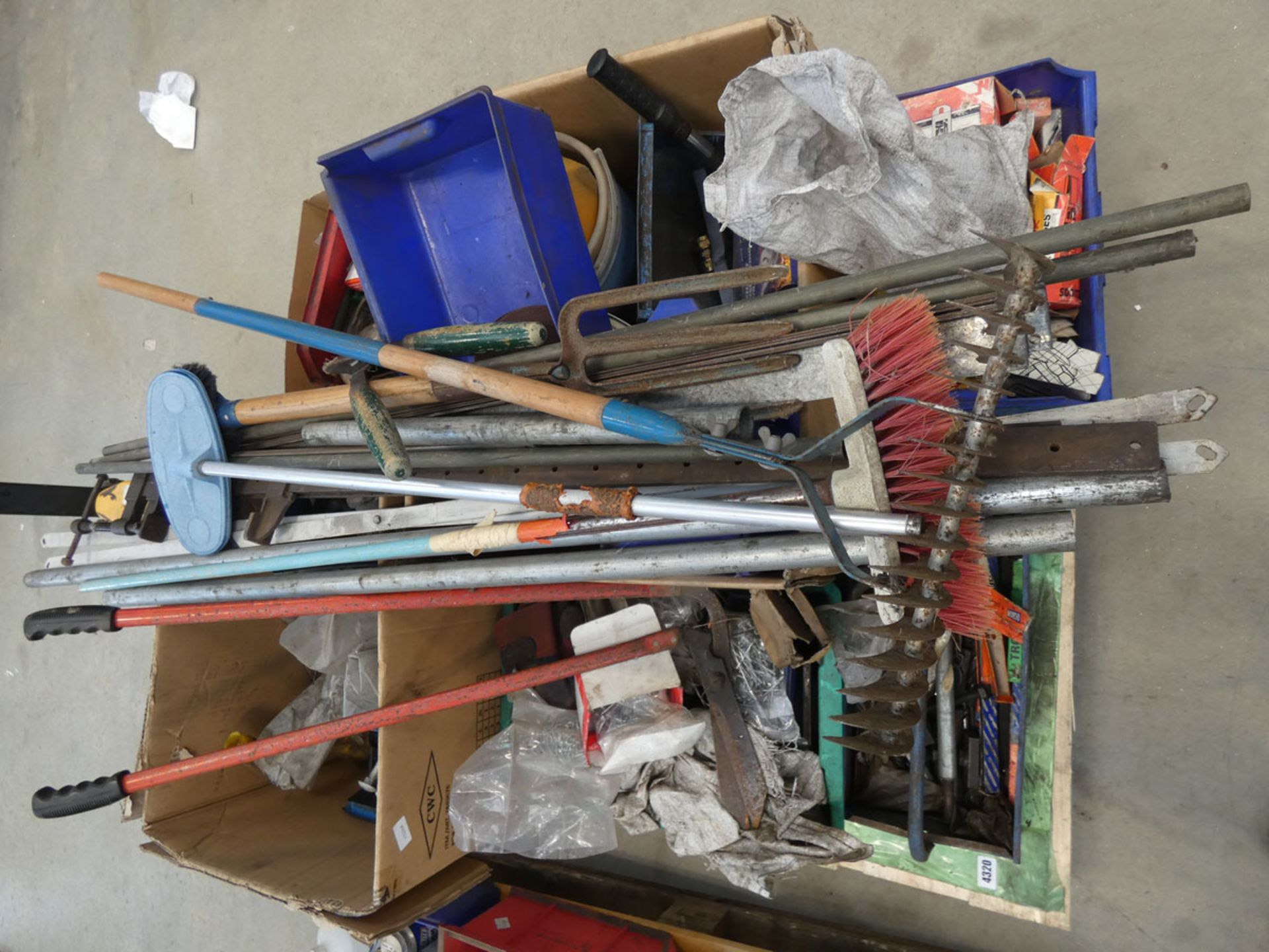Pallet containing G clamps, garden tools, funnels, pop rivets, drill bits, motor spares, lin bins