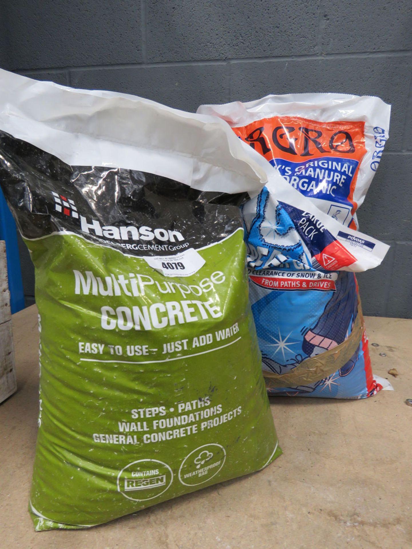 4101 Bag of multi purpose concrete, bag of rock salt, and bag of manure