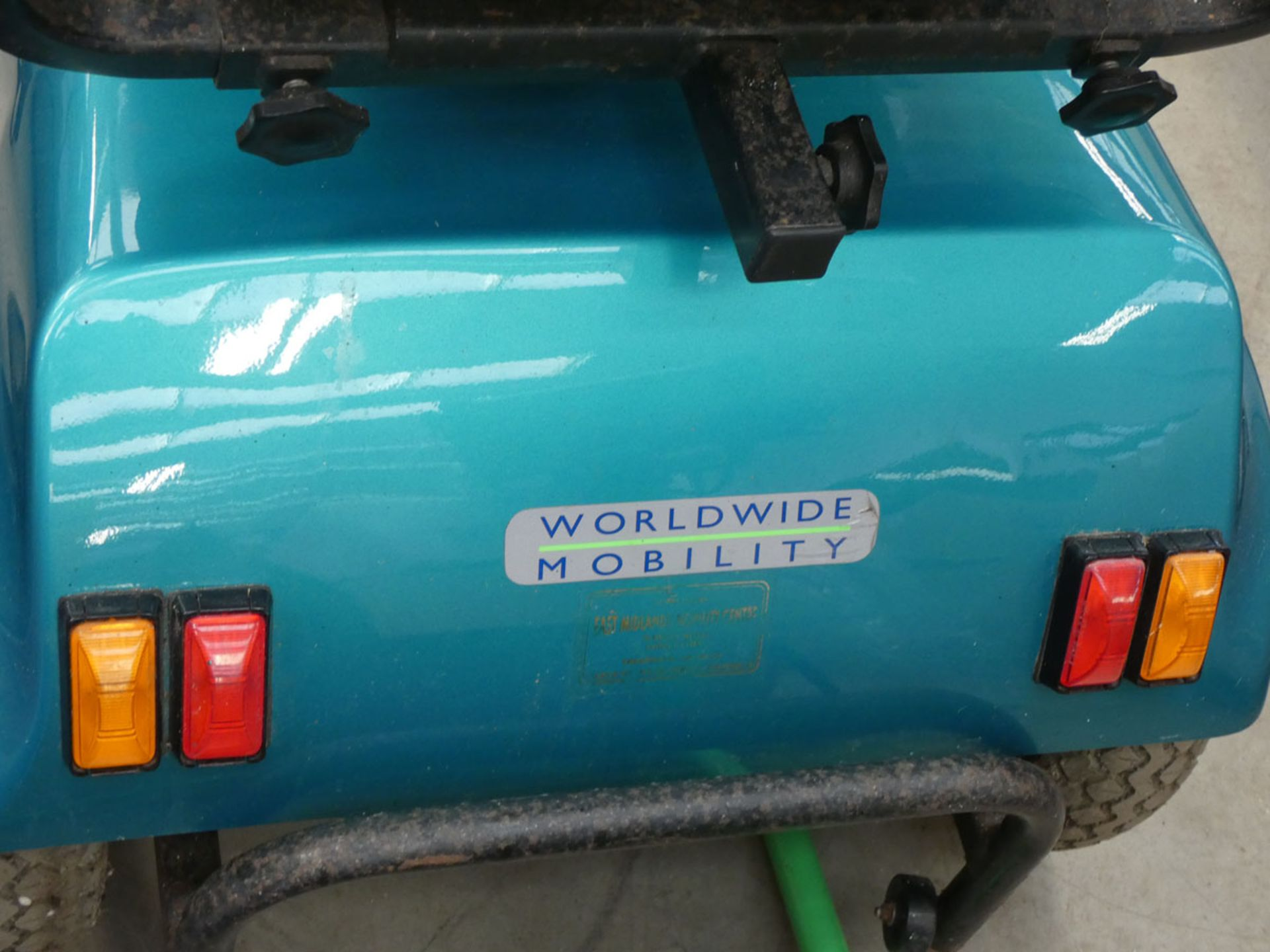 Turquoise mobility scooter with key and charger - Image 4 of 4