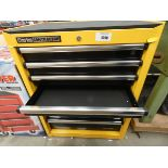 Yellow Clarke tool cabinet with accessories