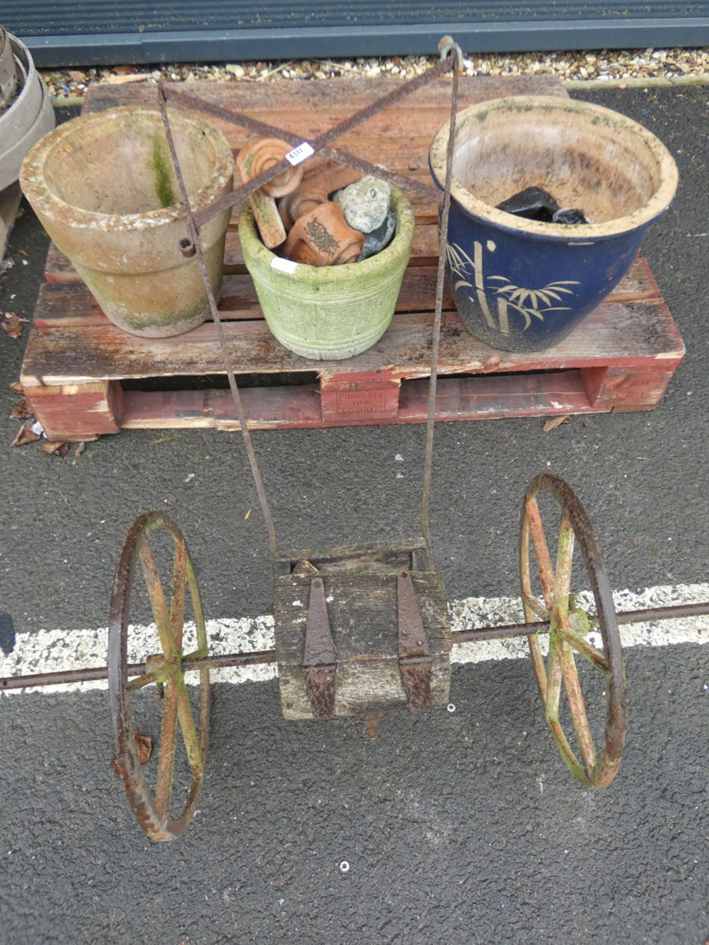 3 pots and a vintage seed spreader