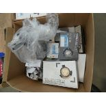 Box of downlights, security lights, and solar spike lights