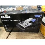 Boxed Casio cash register Lights up and has keys. Item looks quite new.