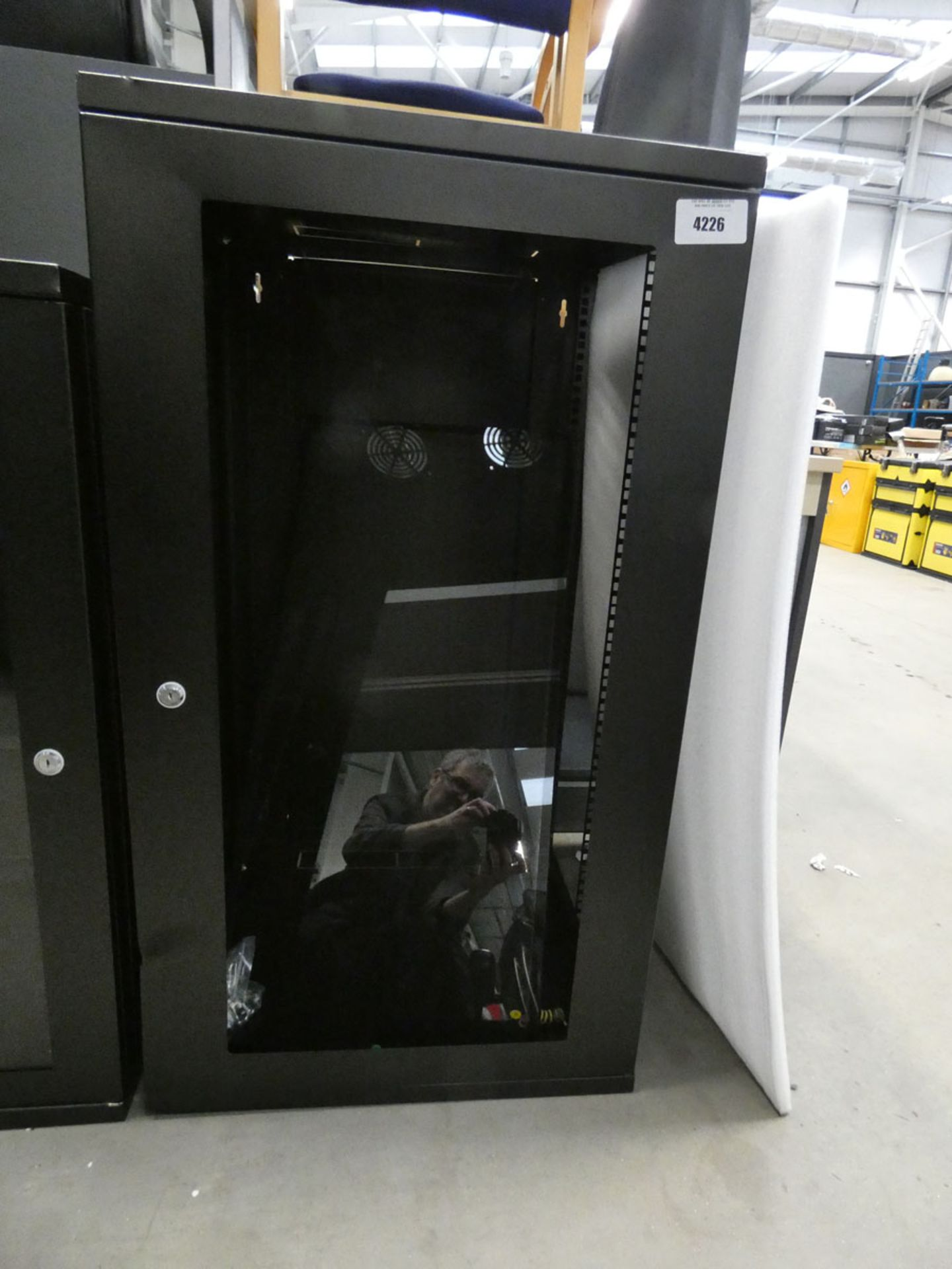 Tall black comms cabinet
