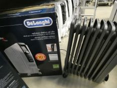 1 large boxed white Delonghi oil filled radiator, and 1 unboxed grey radiator