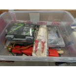 Plastic toolbox containing hot glue gun, wall plugs, riveter, drill bits and various other tools