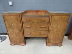 Walnut Art Deco twin-pedestal sideboard with three central drawers and cupboard to the side