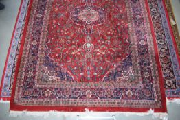 (11) Iranian carpet, red background and blue motifs, approx. 2 x 3m