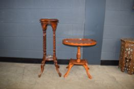 Reproduction yew finish oval occasional table and a 2 tier plant stand