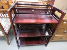 Pair of dark stained folding bookcases