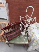 Dark wood magazine rack, thin glass vase, wrought iron umbrella stand and a reproduction side