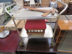 Two wooden set squares, metal 2 tier tea trolley, upholstered footstool, plus a dark wood cabinet