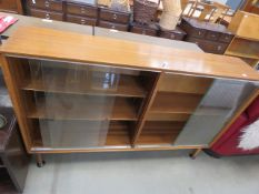 5225 - Teak bookcase with glazed sliding doors A few marks but in sound condition