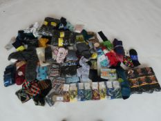 Selection of paired socks (approximately 80 items)