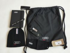 Selection of Audi merchandise to include bag, hat, mask, book, pen, USB stick and lanyard