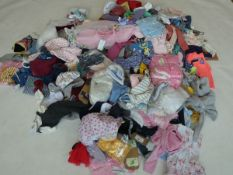 Half a stillage containing children's clothing and accessories ages 3 and under (approximately 235