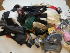 Stillage containing mixed ladies and men's clothing (approximately 165 items)