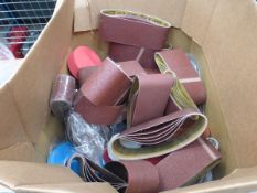 Large cardboard box of sanding belts and pads