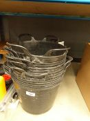 3 large stacks of black plastic buckets