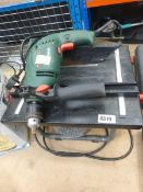 Bosch power drill, portable power washer container and small tile saw