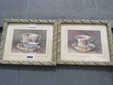 (27) Pair of Barbara Mock watercolours - still life of floral decorated cups and saucers