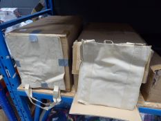 2 boxes containing cream tote bags