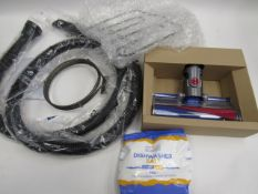 Handheld Dyson fluffy head, oven heater element, heating coil, vacuum pipe, and 2kg bag of