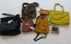 Selection of bags, backpacks, wallets, etc