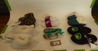 Bag of assorted slippers and sandals