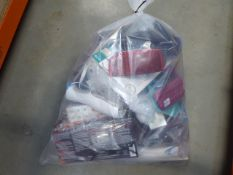 Bag of assorted items to include sun readers, infrared thermometers, hand warmers, swimming goggles,