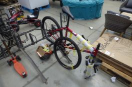 Red gents mountain bike in parts