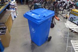 Blue 2 wheeled rubbish bin