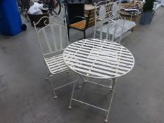 Cream metal folding garden table and 2 matching chairs