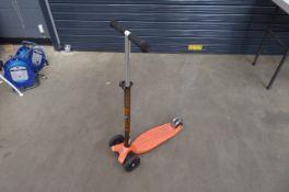 3 wheel orange scooter