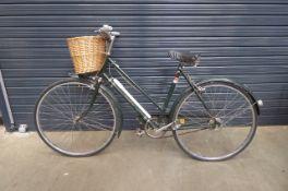 Triumph green vintage ladies bike with front basket