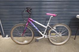 Silver, blue and purple ladies mountain bike Height: 24inch. Frame size 24 inches.