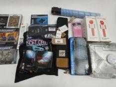 Bag containing microphones, Warhammer packs, toner cartridge, Xbox original, laptop stand etc