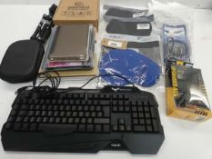Bag containing keyboard, empty Bose headphones case, tripod, 3D printer filament, tablet cases,