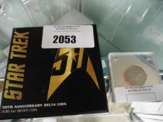 Peter Rabbit 50 pence piece and a Star Trek 50th anniversary delta coin in 1oz silver