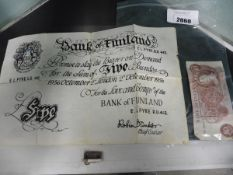 Bank of England Ten Shilling banknote with another deed bank note