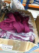 Box containing ladies shiny burgundy tops