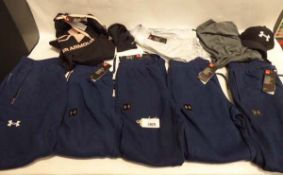 5 pairs of mens Under Armour joggers, 1 pair is used. Ladies Under Armour hoodie, size XL. 2 mens
