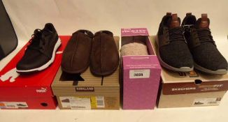 Boxed pair of Puma Grip Sport trainers (size 8.5), pair of Kirkland Sheepskin slippers, pair of