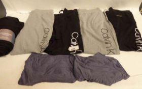 4 pairs of ladies Calvin Klein joggers, untagged and used. Ladies 2 pack pair of Calvin Klein