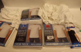 Selection of various mens white t-shirts